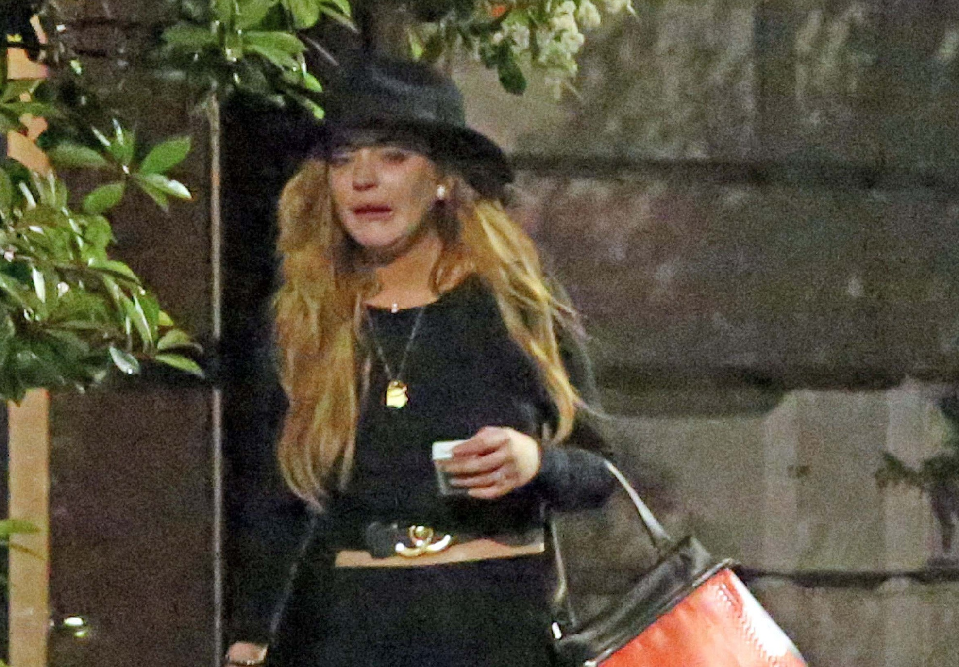 *EXCLUSIVE* A sobbing Lindsay Lohan fights with a mystery man in Milan **USA ONLY** **MUST CALL FOR PRICING**