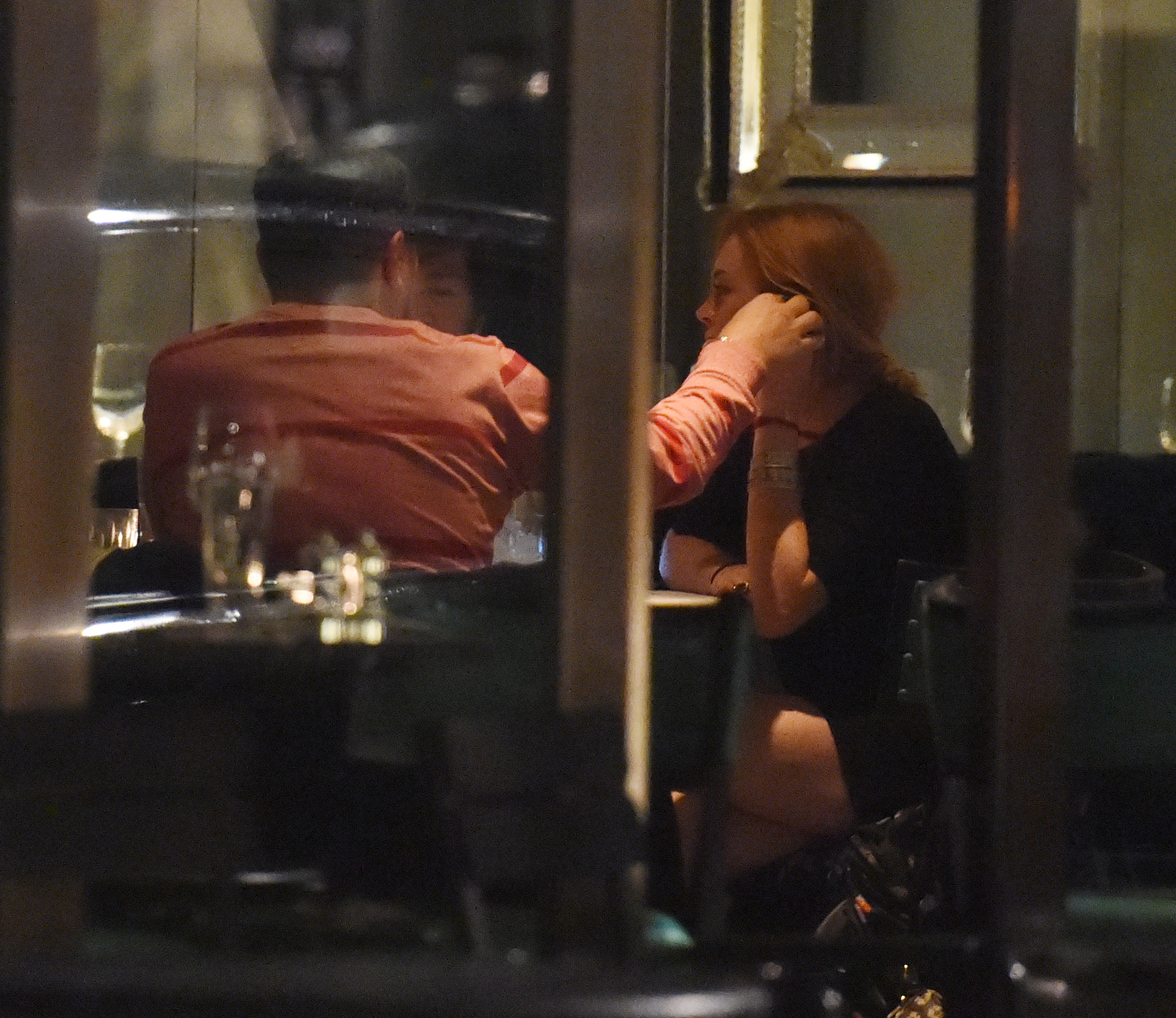 EXCLUSIVE: Lindsay Lohan gets cosy with mystery male companion in London.