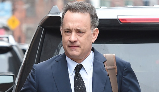 Tom Hanks leaves a meeting downtown in NYC.