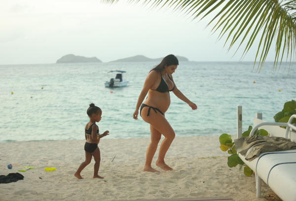 EXCLUSIVE: **PREMIUM EXCLUSIVE RATES APPLY **STRICTLY NO WEB UNTIL 11AM GMT SEPT 3RD** Pregnant Kim Kardashian spends some time with her daughter, North on her last day on vacation in St Bart's