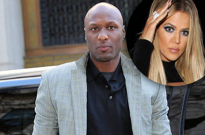 Lamar Odom flashes a embroidered patch titled _Exclusively tailored for Lamar Odom_ when arriving at NY Supreme court for a custody hearing with his ex girlfriend
