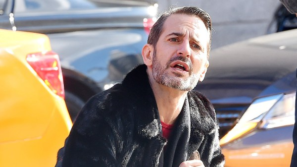 Marc Jacobs stops to do a quick impromptu photo shoot with his bull terrier