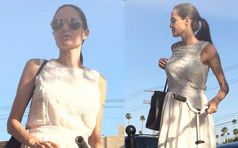 angelina jolie skinny arms scooter ride pics