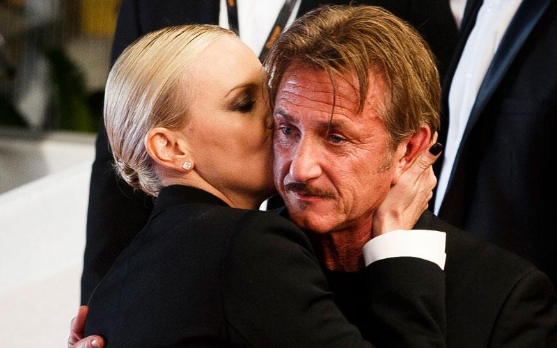 sean penn charlize theron kiss pda cannes red carpet