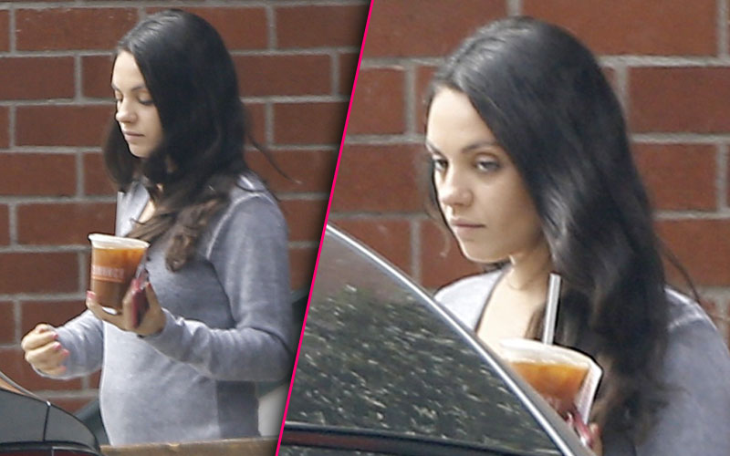 mila kunis pregnant baby bump exhausted pics