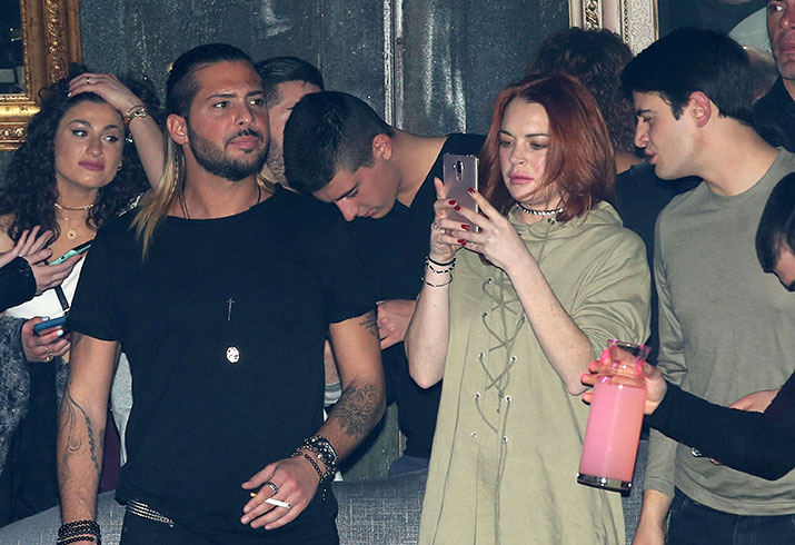 Lindsay lohan smoking drinking club greece