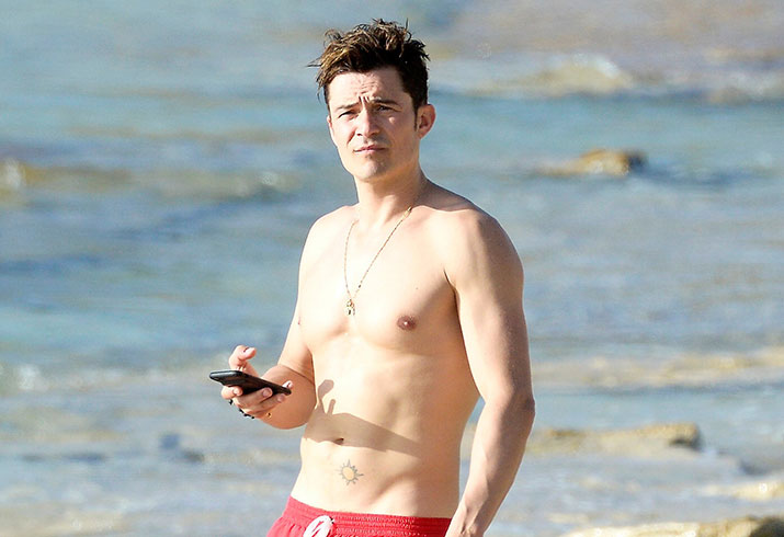 Orlando bloom beach vacation yacht shirtless photos
