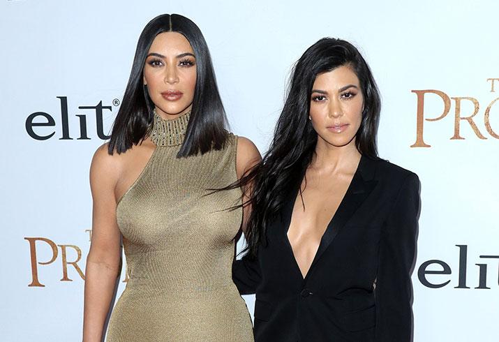 Kim kardashian gold dress red carpet movie premiere