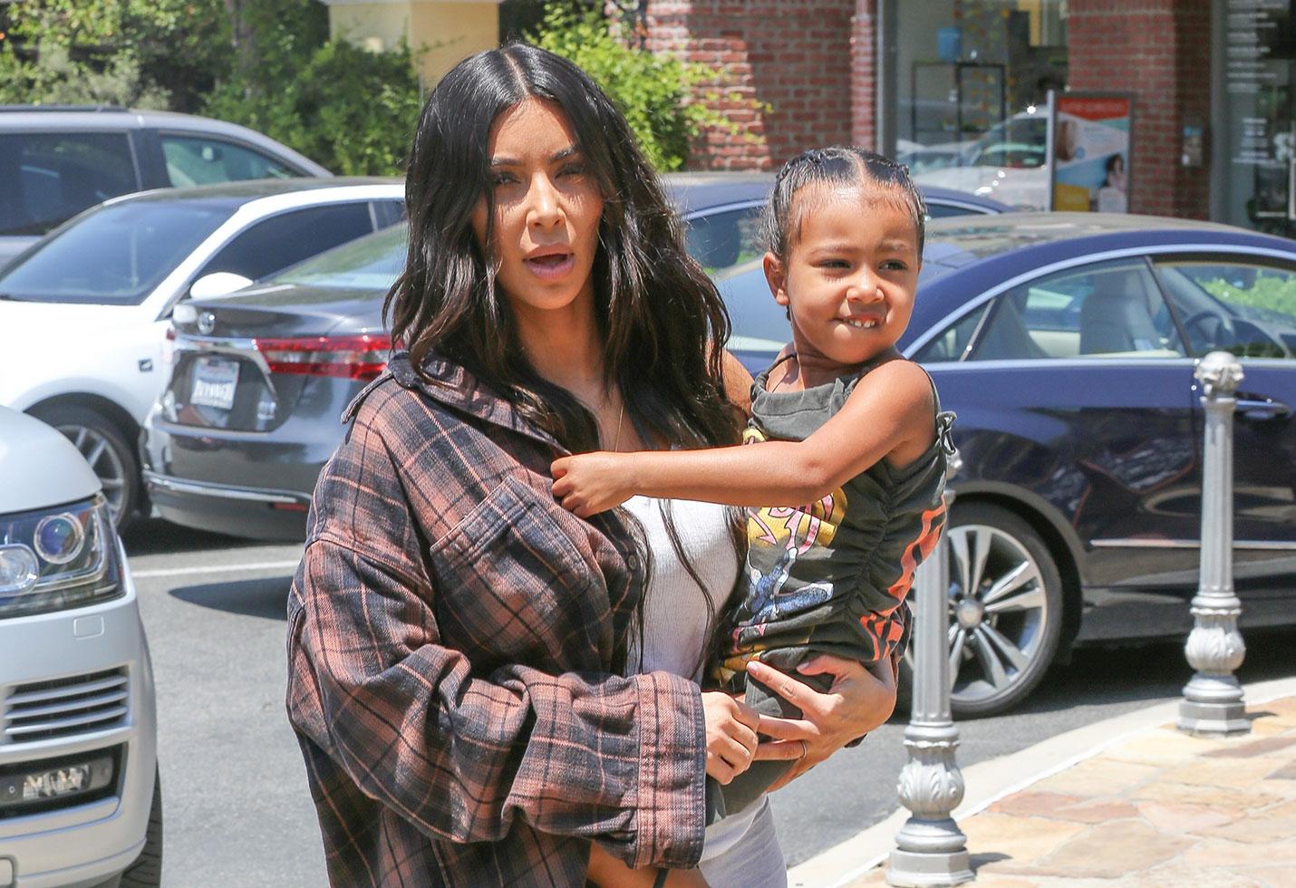 Kim kardashian surrogate family north west