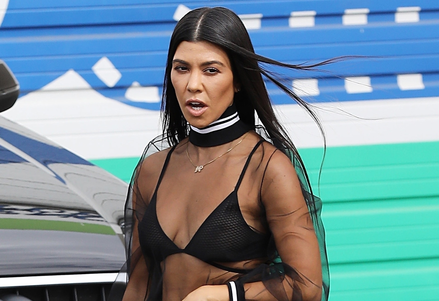 Kourtney Kardashian shows off her toned physique in a mesh top as she leaves the studio