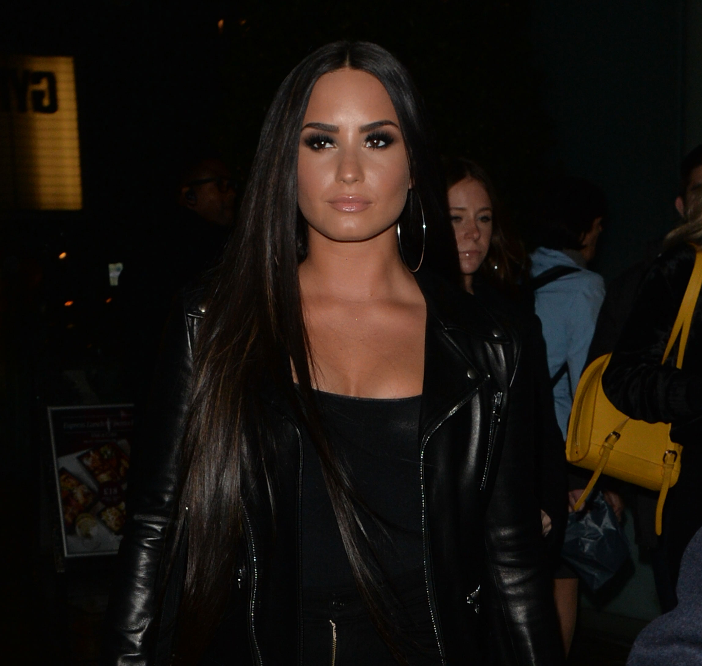 Demi lovato shows off soccer match chic look feature