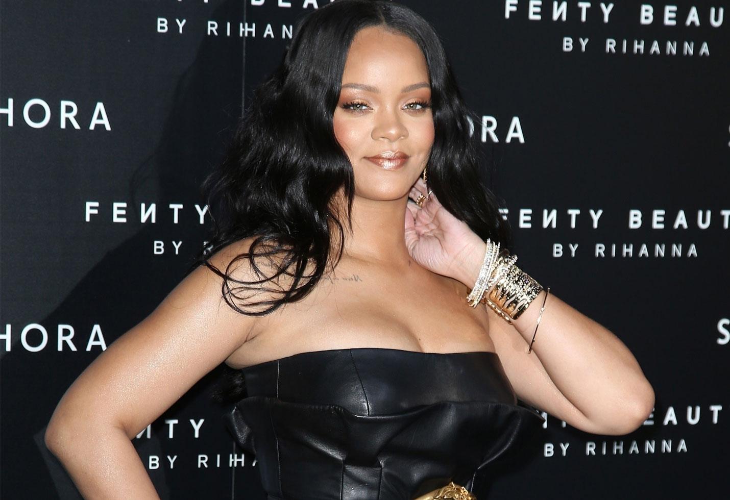Rihanna shows off major weightloss tight black dress