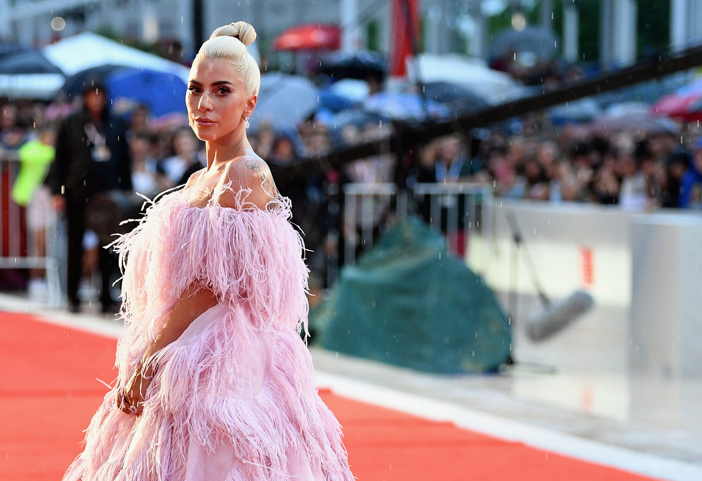 f58e085577f Lady Gaga Stuns In Pink Dress On Rainy Venice Film Festival Red Carpet. The  pop superstar shines in 'A Star Is Born' ...