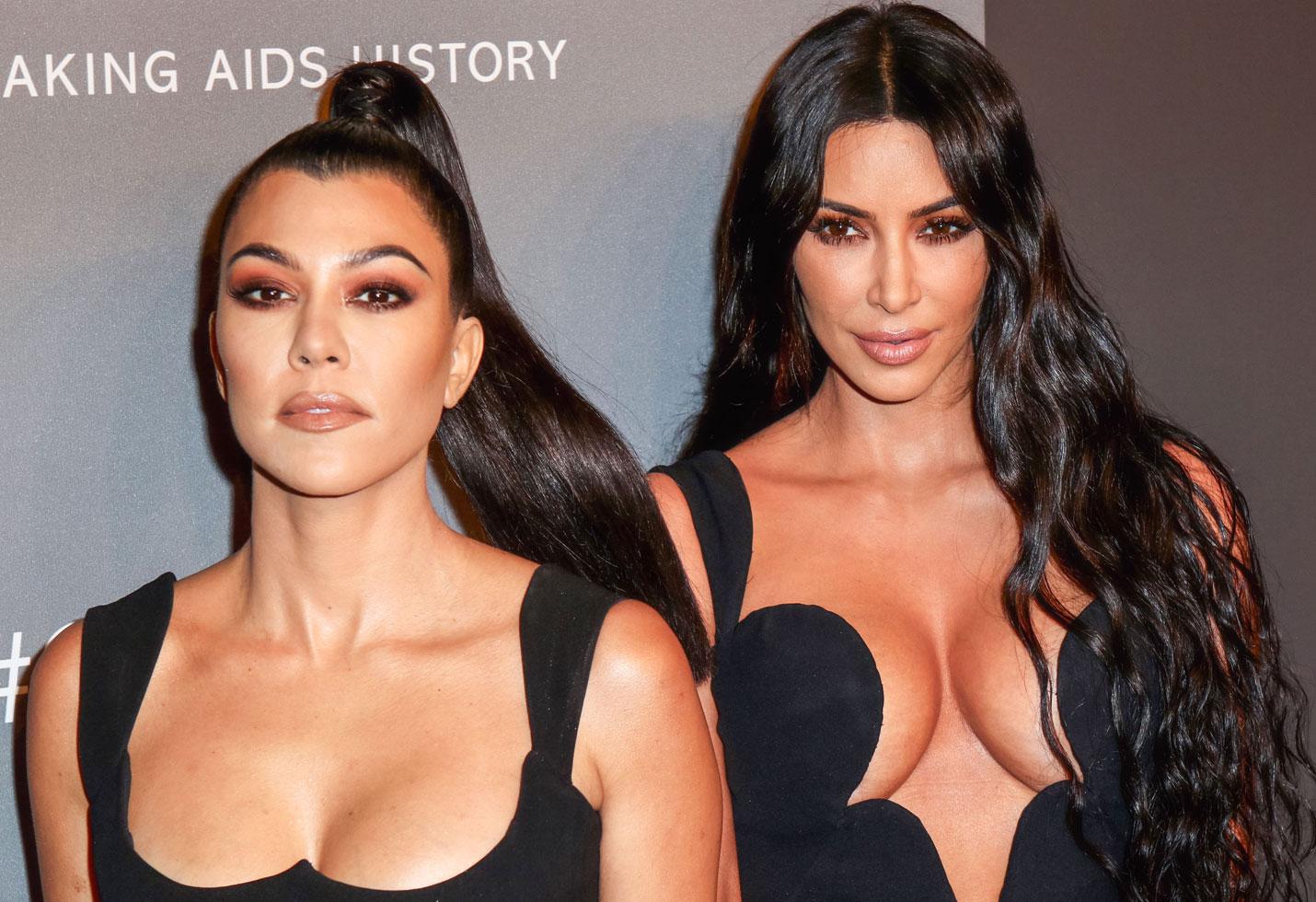 Kim kourtney kardashian matching dresses cleavage photos