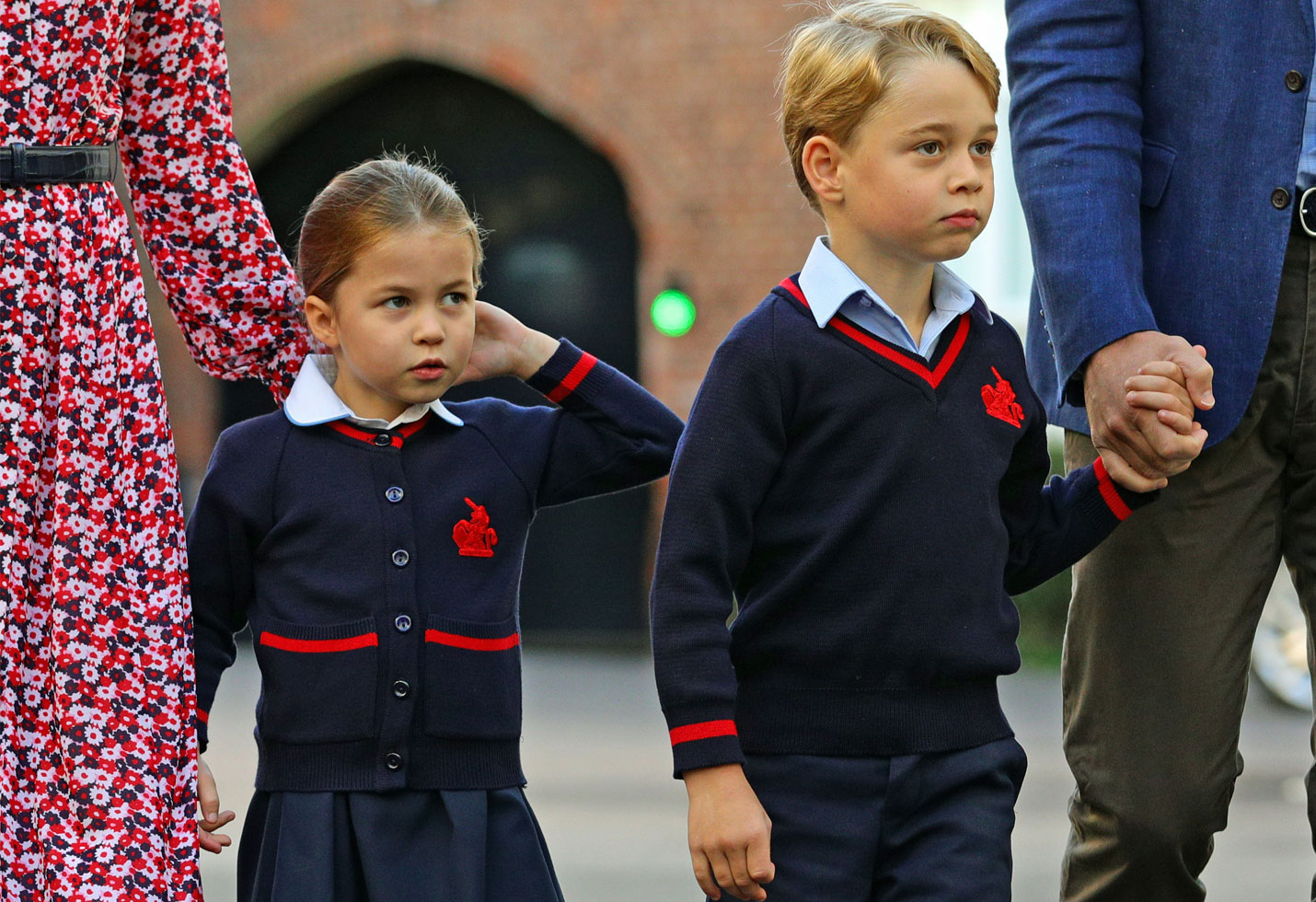 Princess Charlotte arrives for her first day of school, with her brother Prince George and her parents The Duke and Duchess of Cambridge