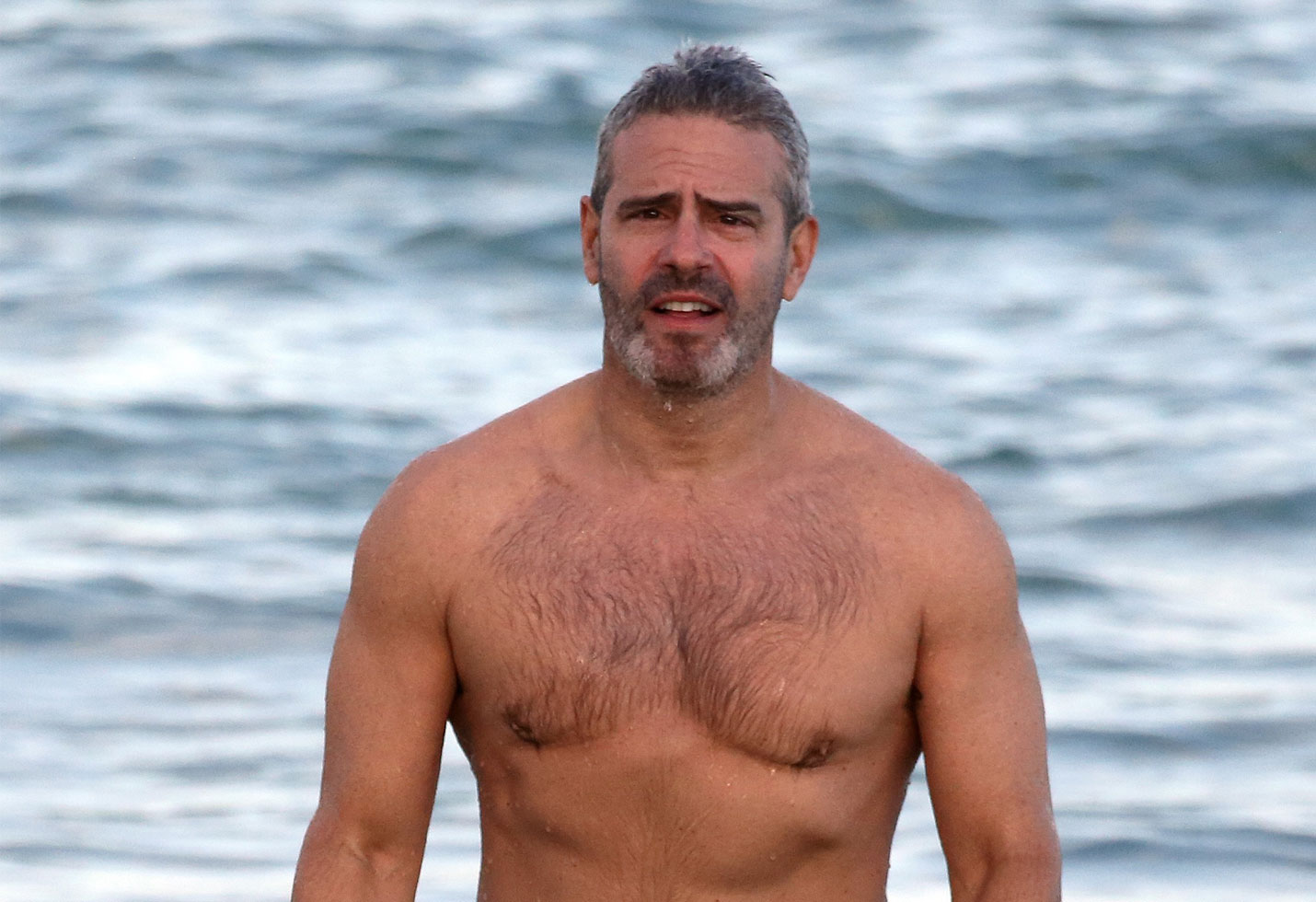 Andy Cohen shirtless on the beach with his son, Benjamin in Miami