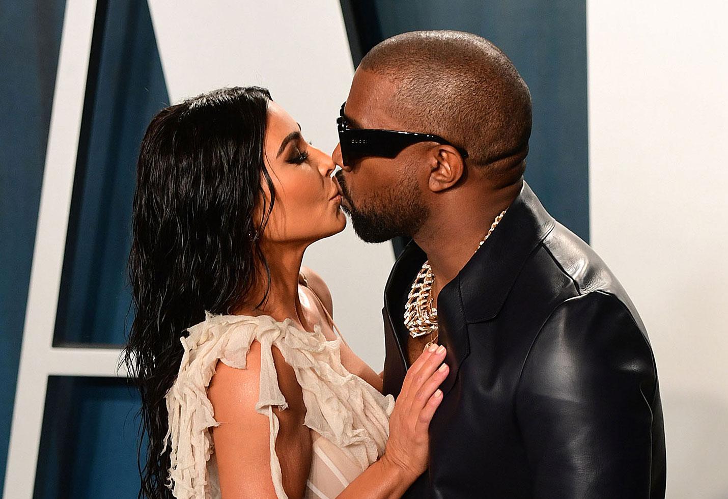Kim Kardashian and Kanye West Kissing